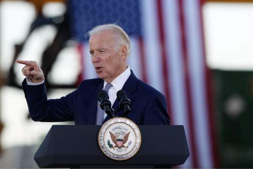 Vice President Joe Biden delivers a speech at the Norfolk Southern Memphis Regional Intermodal Facility in Rossville, outside of Memphis, Tenn., to commemorate the 7th anniversary of the American Recovery and Reinvestment Act on Wednesday, Feb. 17, 2016. (Mike Brown/The Commercial Appeal via AP) MANDATORY CREDIT