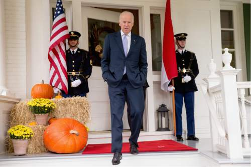 Vice President Joe Biden arrives to speak to members of the media about the spending agreement worked out between Congress and the White House before greeting Indonesian President Joko Widodo for lunch, Tuesday, Oct. 27, 2015, at the Naval Observatory in Washington. (AP Photo/Andrew Harnik)