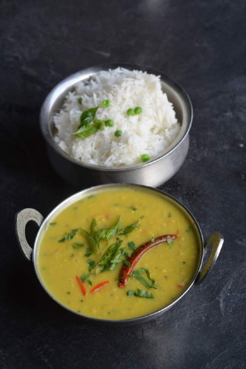 "The dal tadka at Saffron Valley East India Cafe is made with split pigeon peas or  dal, which are seasoned with a ""tadka"" of sautÈed onions, tomatoes and spices. The dish can be served over steamed white rice or alongside flatbreads.  Source: Lavanya Mahate, Saffron Valley owner"