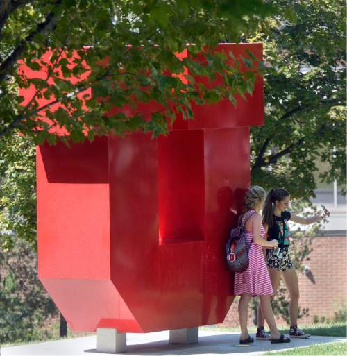 """Al Hartmann     The Salt Lake Tribune Students take a selfie with their phones at the University of Utah's giant """"U"""" near the Olpin Union building during  the first day of Fall 2015 classes."""