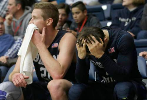 BYU forward Kyle Davis, left, and guard Nick Emery sit on the bench during the second half of an NCAA college basketball game against Saint Mary's (Calif.) in Moraga, Calif., Thursday, Dec. 31, 2015. Saint Mary's won 85-74. (AP Photo/Jeff Chiu)