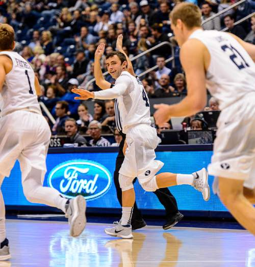 Trent Nelson  |  The Salt Lake Tribune Brigham Young Cougars guard Nick Emery (4) celebrates a three-pointer as BYU hosts Mississippi Valley State, NCAA basketball at the Marriott Center in Provo, Wednesday November 25, 2015.