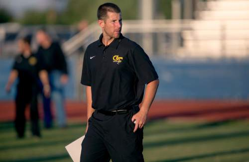Patrick Breen  |  The Arizona Republic  Gilbert's offensive coordinator Max Hall looks over his team before they start a game against Mesquite at Mesquite High School in Gilbert, AZ on Thursday, August 28, 2014.