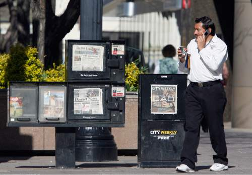 Rick Egan  |  Tribune file photo Newspaper boxes sit on Main Street in Salt Lake City. Reports say that a prospective buyer has emerged for Utah's largest daily, The Salt Lake Tribune.