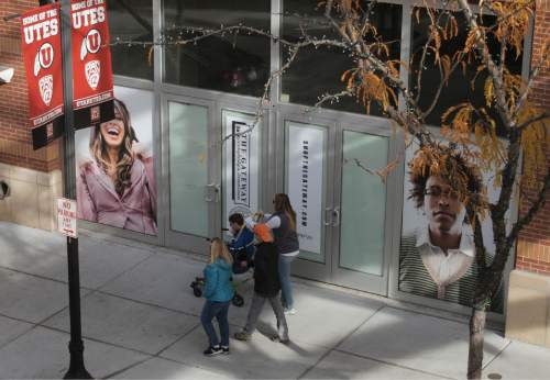 Al Hartmann  |  The Salt Lake Tribune Shoppers pass by empty storefront Monday Nov. 23 at the Gateway in Salt Lake City.