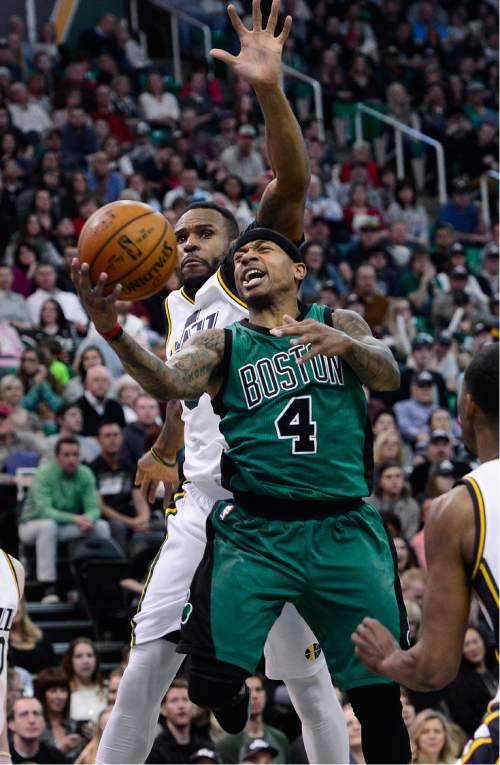 Scott Sommerdorf   |  The Salt Lake Tribune Jazz foreword Trevor Booker defends this shot by Boston guard Isaiah Thomas during first half play. The Utah Jazz led the Boston Celtics 54-49 at the half, Friday, February 19, 2016.