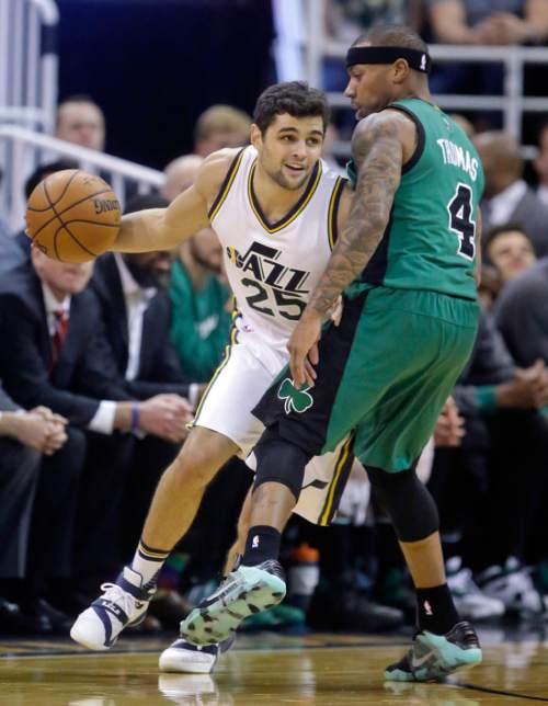 Utah Jazz guard Raul Neto (25) drives around Boston Celtics guard Isaiah Thomas (4) during the first quarter of an NBA basketball game Friday, Feb. 19, 2016, in Salt Lake City. (AP Photo/Rick Bowmer)