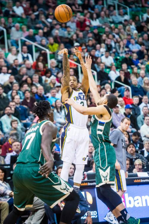 Chris Detrick  |  The Salt Lake Tribune Utah Jazz guard Trey Burke (3) shoots past Milwaukee Bucks guard Tyler Ennis (11) during the game at Vivint Smart Home Arena Friday February 5, 2016.