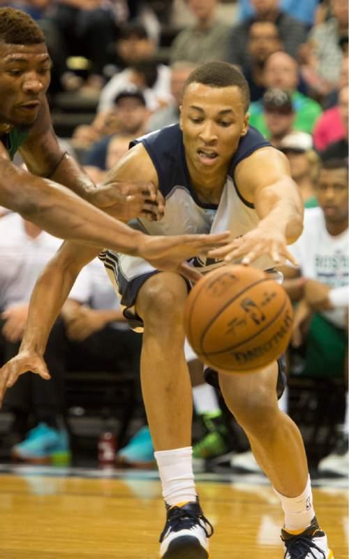 Rick Egan  |  The Salt Lake Tribune  Utah Jazz guard Dante Exum (11) goes for a loose ball along with Boston Celtics guard C.J.Fair (36) in Summer League action, Utah Jazz vs. The Boston Celtics, at EnergySolutions Arena, Monday, July 6, 2015.