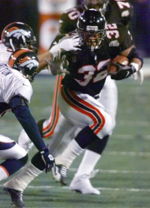 Atlanta Falcons' Jamal Anderson runs in the first quarter of    Super Bowl XXXIII against the Denver Broncos in Miami, Sunday, Jan. 31, 1999. (AP Photo/Elise Amendola)