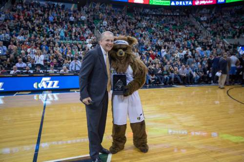 Courtesy  |  NBAE/Getty Images  Utah Jazz President Randy Rigby and the Jazz Bear.