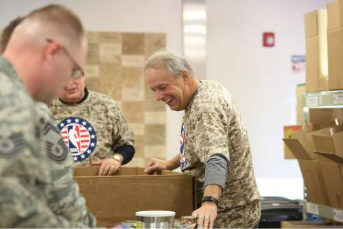 SALT LAKE CITY, UT - NOVEMBER 06:  of the Utah Jazz in honor of Veterans Day the Utah Jazz participated in the Hoops for Troops with the Commitment to Service working along side military members at the Utah Food Bank sorting and packaging food on November 06, 2015 in Salt Lake City, Utah. NOTE TO USER: User expressly acknowledges and agrees that, by downloading and or using this Photograph, User is consenting to the terms and conditions of the Getty Images License Agreement. Mandatory Copyright Notice: Copyright 2015 NBAE (Photo by Melissa Majchrzak/NBAE via Getty Images)