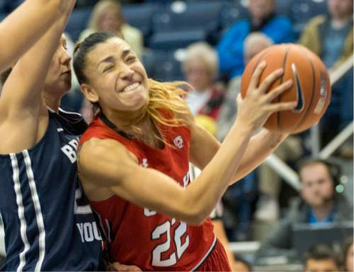 Rick Egan  |  The Salt Lake Tribune  Utah Utes guard Danielle Rodriguez (22) tries to get past Brigham Young Cougars guard/forward Kristine Fuller Nielson (22), in basketball action, BYU vs. Utah, in the Marriott Center, Saturday, December 12, 2015.