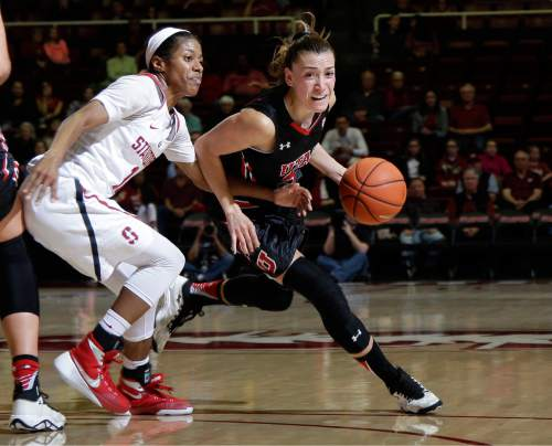 Utah guard Danielle Rodriguez, right, dribbles around Stanford guard Briana Roberson during the first half of an NCAA college basketball game Friday, Jan. 8, 2016, in Stanford, Calif.  (AP Photo/Marcio Jose Sanchez)