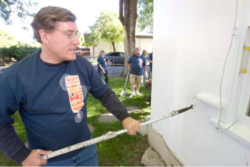 Zions Bank CEO Scott Anderson joined a group of bank employees to  paint the home of 75 year old Marie  Ashton  on  Monday, June 14,2010.  The event was  Zion's 20th annual paint-a-thon where  employees pitch in to paint and spruce up the homes of people  in need.  photo:Paul Fraughton/ The Salt Lake Tribune
