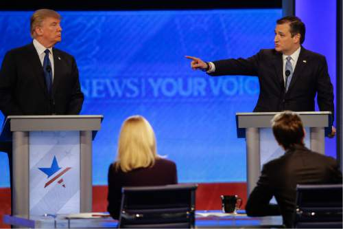 Republican presidential candidate, Sen. Ted Cruz, R-Texas, points at Republican presidential candidate, businessman Donald Trump during a Republican presidential primary debate hosted by ABC News at the St. Anselm College  Saturday, Feb. 6, 2016, in Manchester, N.H. (AP Photo/David Goldman)