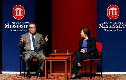 FILE - In this Monday, Dec. 15, 2014, file photo, U.S. Supreme Court Justice Antonin Scalia, left, discusses his background as a law student with fellow Justice Elena Kagan at the University of Mississippi in Oxford, Miss. Mississippi Republicans are fondly remembering Scalia, who was found dead Saturday, Feb. 13, 2016, at a Texas ranch where he had gone to hunt quail. Scalia sometimes combined hunting trips with appearances at Mississippi universities, including the one in 2014 where he and Kagan made a rare joint appearance at the University of Mississippi before going duck hunting in the Mississippi Delta. (AP Photo/Rogelio V. Solis, File)