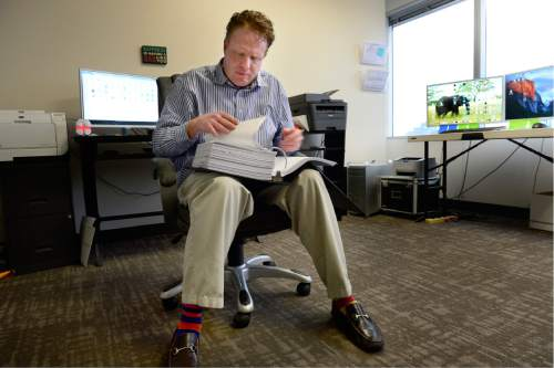 Scott Sommerdorf   |  The Salt Lake Tribune Jeremy Johnson - ensconced in this office preparing for his trial, Thursday, February 4, 2016. He and and two others go on trial Monday, on 86 federal charges.