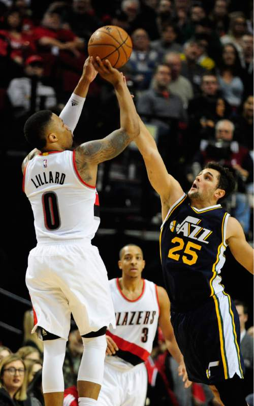 Portland Trail Blazers guard Damian Lillard (0) shoots the ball over Utah Jazz guard Raul Neto (25) during the second half of an NBA basketball game in Portland, Ore., Sunday, Feb. 21, 2016. The Blazers won 115-111.(AP Photo/Steve Dykes)