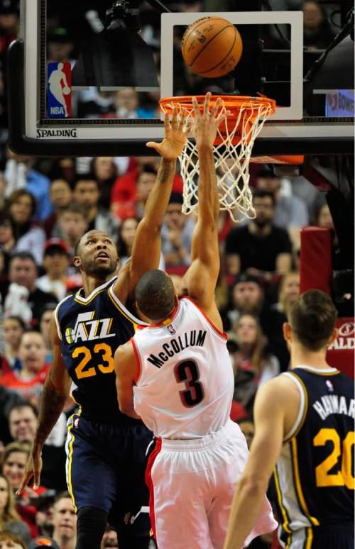 Portland Trail Blazers guard C.J. McCollum (3) drives to the basket on Utah Jazz forward Chris Johnson (23) during the second half of an NBA basketball game in Portland, Ore., Sunday, Feb. 21, 2016. The Blazers won 115-111.(AP Photo/Steve Dykes)