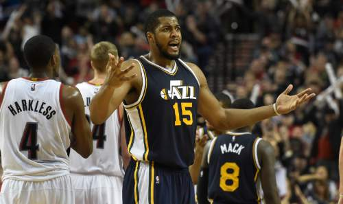 Utah Jazz forward Derrick Favors (15) reacts to an officials call during the fourth quarter of an NBA basketball game against the Portland Trail Blazers in Portland, Ore., Sunday, Feb. 21, 2016. The Blazers won 115-111.(AP Photo/Steve Dykes)