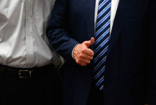 Republican presidential candidate Donald Trump gives a thumbs up during a visit to Tommy's Country Ham House, Tuesday, Feb. 16, 2016, in Greenville, S.C. (AP Photo/Paul Sancya)