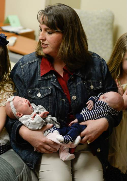 Francisco Kjolseth | The Salt Lake Tribune Kelli Wall holds her new born twins Kenadee and Kyler while visiting with her own identical twin sister Kerri Bunker. Each of the two recently delivered their second set of twins at the same hospital for the second time in a row.