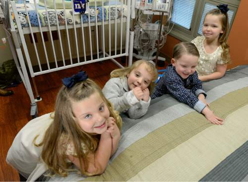 Francisco Kjolseth | The Salt Lake Tribune Madison Wall, 5, left, and her twin sister McKell, far right, join their cousins, Hallie and Kole Bunker, 4, who are also twins, as they meet another set of twins added to the family. Identical twin sisters Kerri Bunker and Kelli Wall, became pregnant around the same time. Fast forward to the last three weeks, and they each delivered a second set of twins at Timpanogos Regional Hospital. These twin moms previously delivered their first set of twins at the same hospital within a few months of each other.