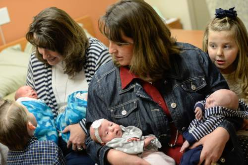 Francisco Kjolseth | The Salt Lake Tribune Identical twin sisters Kerri Bunker, left, and Kelli Wall, became pregnant around the same time. Fast forward to the last three weeks, and they each delivered a second set of twins at Timpanogos Regional Hospital. These twin moms previously delivered their first set of twins at the same hospital within a few months of each other.