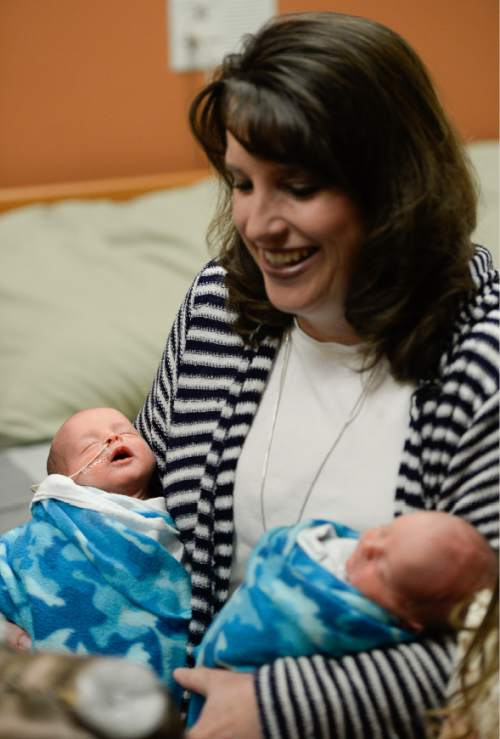 Francisco Kjolseth | The Salt Lake Tribune Kerri Bunker holds her twin boys Kash and Jace at Timpanogos Regional Hospital. Kerri and her twin sister Kelli Wall both just delivered their second set of twins.