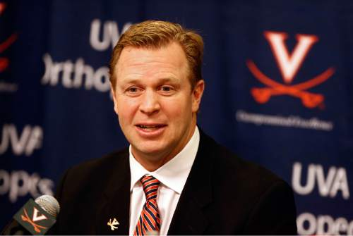 Virginia head football coach Bronco Mendenhall speaks during a press conference on national signing day on Wednesday, Feb. 3, 2016 in Charlottesville, Va. (Ryan M. Kelly/The Daily Progress via AP) MANDATORY CREDIT