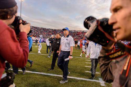 Trent Nelson  |  The Salt Lake Tribune BYU coach Bronco Mendenhall walks off the field following as Utah defeats BYU 35-28 in the Royal Purple Las Vegas Bowl, NCAA football at Sam Boyd Stadium in Las Vegas, Saturday December 19, 2015.