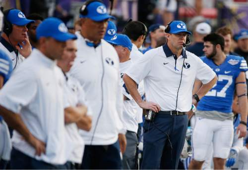 BYU head coach Bronco Mendenhall, right, watches his team against Utah during the second half of the Las Vegas Bowl NCAA college football game Saturday, Dec. 19, 2015, in Las Vegas. Utah won 35-28. (AP Photo/John Locher)