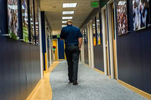 Chris Detrick  |  The Salt Lake Tribune Cougar football head coach Bronco Mendenhall walks away after a press conference at Brigham Young University Friday December 4, 2015.  Mendenhall signed a five-year contract with the University of Virginia that will pay him $3.25 million annually, estimated to be more than three times the money he makes coaching BYU.