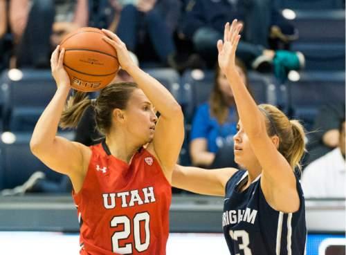 Rick Egan  |  The Salt Lake Tribune  Utah Utes guard Katie Kuklok (20) is guarded by Brigham Young Cougars guard Makenzi Morrison Pulsipher (23), in the Marriott Center, Saturday, December 12, 2015.