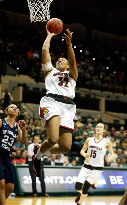Louisville Cardinals forward Emmonnie Henderson (32) goes up for a shot in front of Brigham Young Cougars guard Makenzi Morrison (23) during the second half of an NCAA women's college basketball tournament game, Saturday, March 21, 2015, in Tampa, Fla. (AP Photo/Brian Blanco)