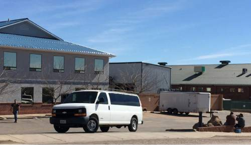 This photo provided by Andrew Chatwin shows law enforcement officers, left, conducting a search at Reliance Electric in Hildale, Utah, Tuesday, Feb. 23, 2016. Police are searching businesses in a polygamous town on the Utah-Arizona border. The U.S. Attorney's Office in Utah said in statement Tuesday that federal, state and local authorities are carrying out actions approved by a court. Officials didn't elaborate, saying court documents are sealed. (Andrew Chatwin via AP)