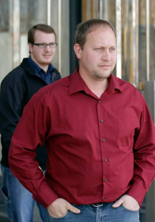 Thomas Jeffs, son of Lyle Jeffs, right, and Roy Jeffs, son of jailed polygamous leader Warren Jeffs, leave the federal courthouse Wednesday, Feb. 24, 2016, in Salt Lake City. Lyle Jeffs and another polygamous sect leader in Utah are pleading not guilty to orchestrating what prosecutors call a wide-ranging food-stamp fraud scheme. The two men are former members of the sect. (AP Photo/Rick Bowmer)