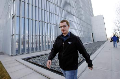 Roy Jeffs, son of jailed polygamous leader Warren Jeffs, leaves the federal courthouse Wednesday, Feb. 24, 2016, in Salt Lake City. Lyle Jeffs and another polygamous sect leader in Utah are pleading not guilty to orchestrating what prosecutors call a wide-ranging food-stamp fraud scheme. Roy Jeffs is former member of the sect. (AP Photo/Rick Bowmer)