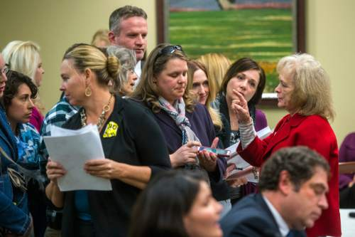 Chris Detrick  |  The Salt Lake Tribune Utah Eagle Forum's Gayle Ruzicka organizes who is going to speak about HB0246 during a House Education Committee meeting Tuesday February 23, 2016.
