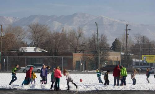 Keith Johnson | The Salt Lake Tribune  Inversion partially obscures the Wasatch Mountains as Hawthorne Elementary School students enjoy recess, December 17, 2013 in Salt Lake City.