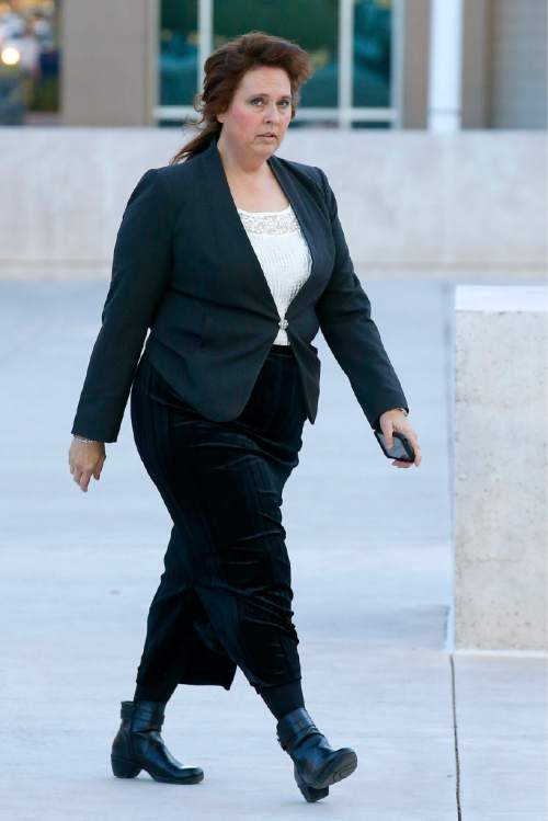 Charlene Jeffs, the estranged wife of Lyle Jeffs of the Fundamentalist Church of Jesus Christ of Latter Day Saints sect, arrives to testify at the Sandra Day O'Connor United States District Court in the federal civil rights trial against two polygamous towns on the Arizona-Utah line Wednesday, Jan. 27, 2016, in Phoenix. (AP Photo/Ross D. Franklin)
