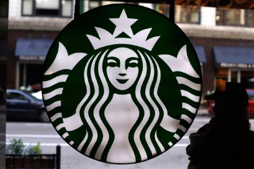 FILE - In this Saturday, May 31, 2014, file photo, the Starbucks logo is seen at one of the company's coffee shops in downtown Chicago. (AP Photo/Gene J. Puskar, File)