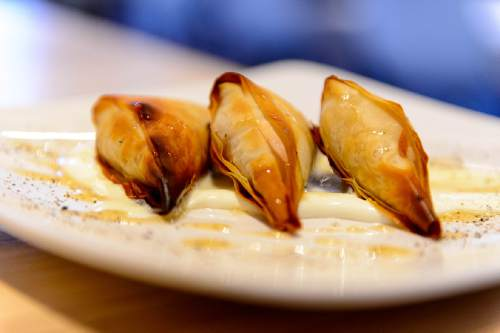 Trent Nelson  |  The Salt Lake Tribune Kolokithopita (butternut squash, goat cheese, crispy phyllo, crème fraîche, black pepper honey) at Manoli's, a new Greek restaurant in Salt Lake City specializing in small plates.