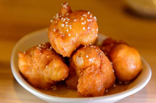 Trent Nelson  |  The Salt Lake Tribune Loukoumathes (Greek donuts, spiced honey syrup, sesame seeds) at  Manoli's, a new highend Greek restaurant in Salt Lake City specializing in small plates.