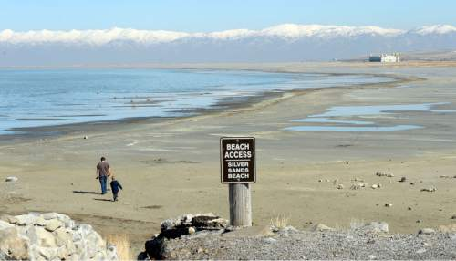 Al Hartmann  |  The Salt Lake Tribune Signs of the Great Salt Lake's low water level is evident at the Great Salt Lake Marina State Park Thursday Feb 25.   The good news is there's plenty of beach to explore at Silver Sands Beach.  The bad news is that the lake is still dropping.  The lake has been steadily falling since 2012.  Salt Air building in the distance sits high and dry.  In the mid-1980's it was surrounded by water when the lake was at a modern day high level.
