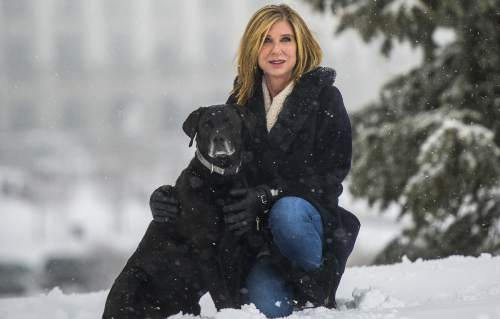 Chris Detrick  |  The Salt Lake Tribune Carrie Snyder poses for a portrait with her dog Henry Saturday January 30, 2016. Snyder has stage 4 lung cancer. Utah lawmakers are sponsoring bill to allow terminally ill patients to receive a prescription for life-ending drugs.