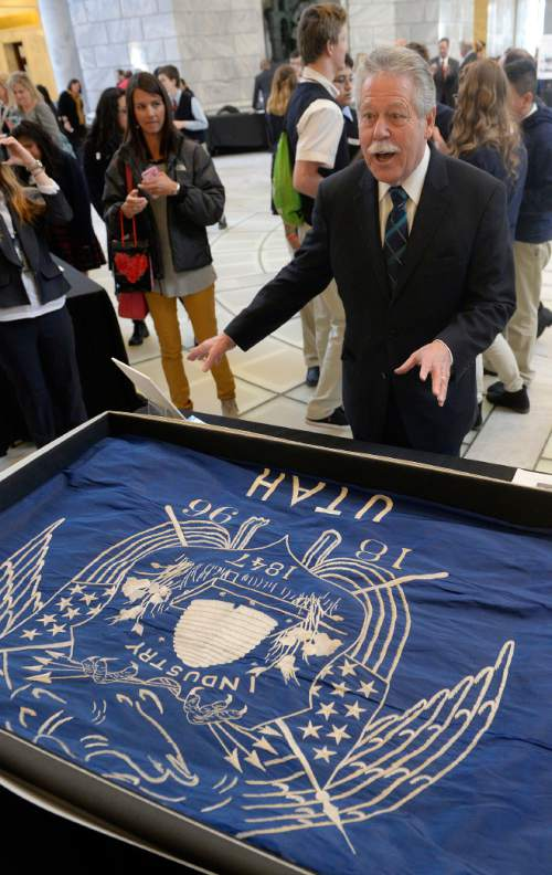 Al Hartmann  |  The Salt Lake Tribune Senate Minority Leader Gene Davis looks at the first Utah state flag created in 1903 by the request of Governor Heber M. Wells.  The flag was on display along with many exhibits and unusual state items at History Day on the Hill in the Capitol rotunda.