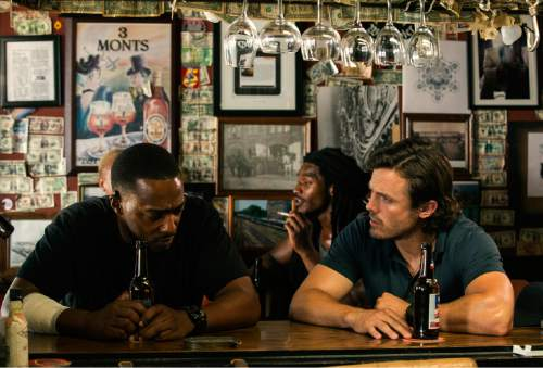 "This image released by Open Road Films shows Anthony Mackie, left, and Casey Affleck in a scene from ""Triple 9."" (Bob Mahoney/Open Road Films via AP)"