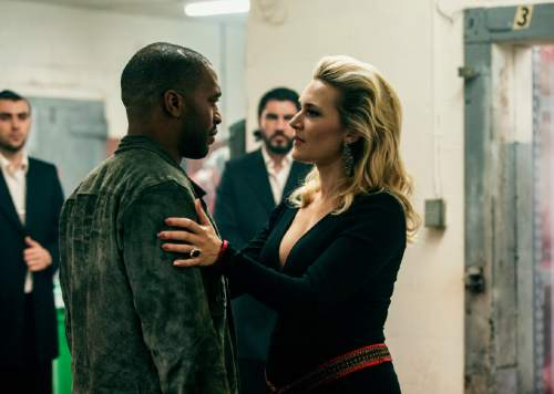 "This image released by Open Road Films shows Chiwetel Ejiofor, left, and Kate Winslet in a scene from ""Triple 9."" (Bob Mahoney/Open Road Films via AP)"